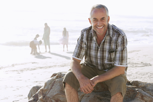 middle-aged man smiling on the beach